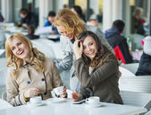 Group of laughing young women — Stock Photo