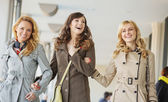 Three cheerful ladies walking during the spring day — Stock Photo