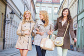 Two blonde and one brunette woman — Stock Photo