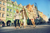 Pretty ladies in the crowdy downtown — Stock Photo