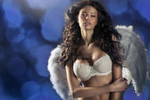 Woman angel with hundreds flashes in the background — Stock Photo
