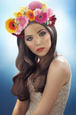 Young pretty girl with the flower hat — Stock Photo