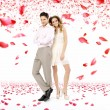 Elegant young couple in the petal rain — Stock Photo #45133631