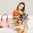 Attractive woman carrying a heap of shoes — Stock Photo #45136485