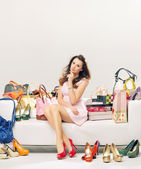 Elegant lady in a place full of fashion accessories — Stock Photo