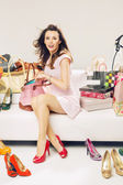 Smart woman in a place full of fashion accessories — Stock Photo