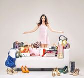 Attractive young woman showing her shopping — Stock Photo