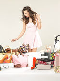 Cheerful brunette woman in the shoe shop — Stock Photo