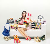 Cheerful young woman with plenty of shopping bags — Stock Photo