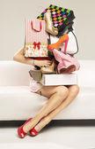 Beautiful woman carrying plenty of shopping bags — Stock Photo