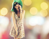 Portrait of pretty cheerful woman wearing hat — Stock Photo