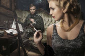 Smoking german soldier with his lovely wife — Stock Photo