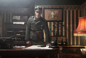 Tall blonde german soldier in his office — Stock fotografie