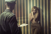 Frightened lady during the interrogation — Stockfoto