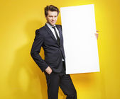 Handsome gentleman carrying white board — Stock Photo