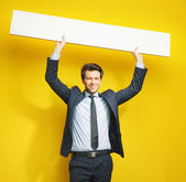 Young cheerful gentleman with board — Stock Photo