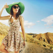 Brunette cutie with huge sunglasses and green hat — Stock Photo #45165583