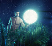 Strong hero carrying the bright moon — Stock Photo