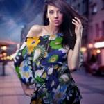 Cute brunette posing on a city street — Stock Photo #4579350