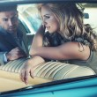 Relaxed young couple in the retro car — Stock Photo #46728201