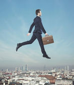 Elegant man jumping in the air — Stock Photo