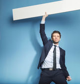 Successful handsome guy with the empty board — Stock Photo