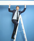 Joyful businessman setting the advert — Stock Photo