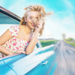 Blond lady during the fast ride — Stock Photo #46730705