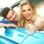 Joyful couple enjoying the fast ride — Stock Photo #46730853