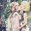 Two forest nymphs weraing fancy hats — Stock Photo