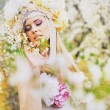 Young blond lady in the fragrant garden — Stock Photo
