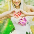 Fresh young lady making the heart sign — Stock Photo