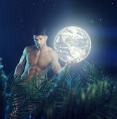 Muscular guy holding the Earth — Stock Photo