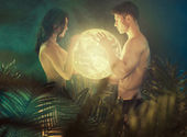Nude couple holding the shiny Earth — Stok fotoğraf