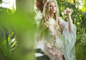 Gorgeous blond nymph walking in the forest — Stock Photo