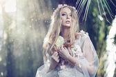 Gorgeous delicate woman with the sun beams in the background — Stock Photo