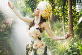 Shiny dark-haired nymph in the rain forest — Stock Photo