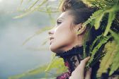 Brunette woman in the tropical forest — Stock Photo