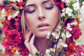 Sensual blonde woman with flowers — Stock Photo