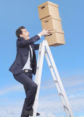Young manager loosing the boxes — Stock Photo