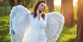 Satisfied angel heated by the sun beams — Stock Photo
