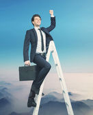 Ambitious businessman trying to get to the top — Stock Photo