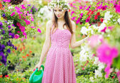Pretty young lady in the fragrant garden — Stock Photo
