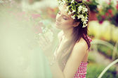 Charming girl with the flower hat — Stock Photo