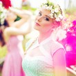 Blonde and brunette wearing flower wreaths — Stock Photo
