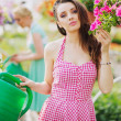 Fantastic brunette cutie in the garden — Stock Photo
