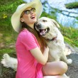 Attractive woman playing with lovely dog — Stock Photo #49033989