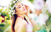 Pretty brunette lady with the colorful wreath on the head — Stock Photo