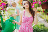 Fantastic brunette cutie in the garden — Stok fotoğraf