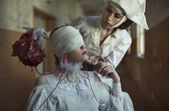 Blind patient and nurse in the creepy hospital — Stock Photo